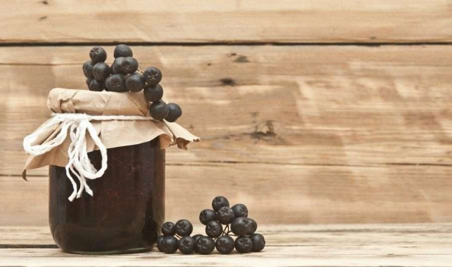http://www.dreamstime.com/stock-images-black-chokeberry-jam-wooden-background-image34687554